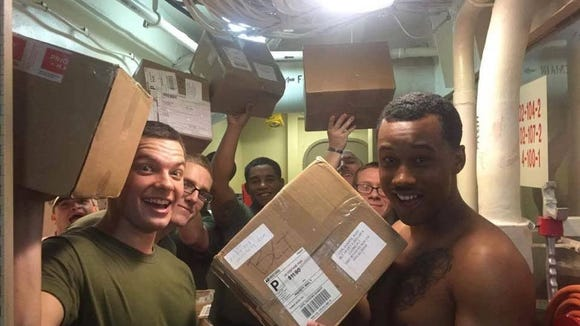 Troops pose with boxes