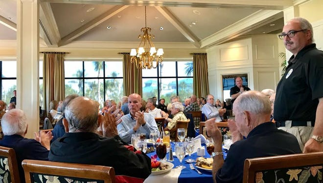 """Members of the Marco Island Police Department stand for recognition during the Marco Island Police Foundation's """"Lunch with the Chief"""" event on January 16, 2018."""