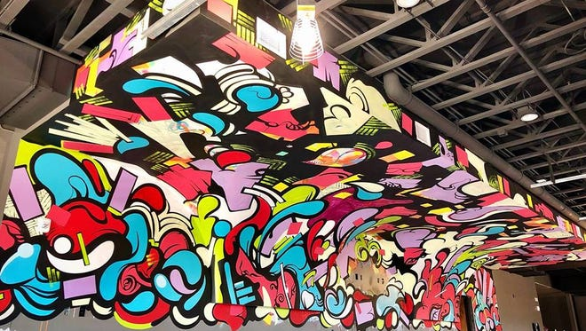 Sioux Falls artist Shaine Schroeder recently completed a large mural inside PAve's second floor addition.