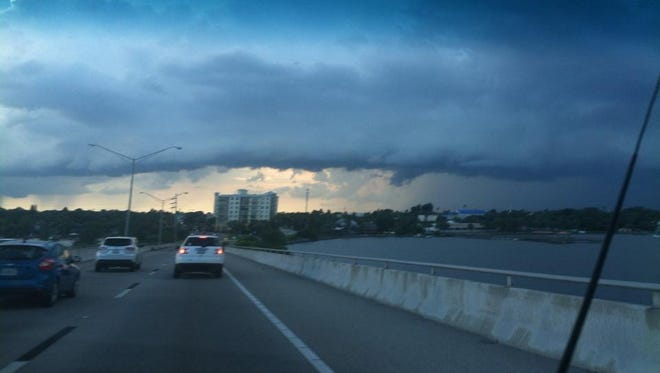 FILE - Approaching storms as seen from the Eau Gallie Causeway.