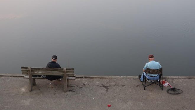 Two men get in some early fishing Monday at Winton Lake.
