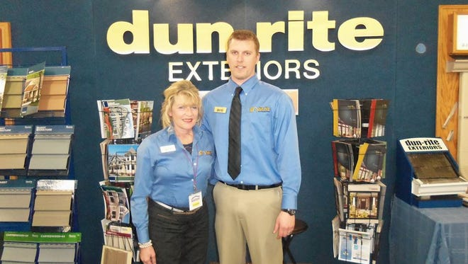 Owner Gloria Fenhaus, left, and field supervisor Justin Schulz operate Dun-Rite Exteriors in Schofield and attribute the company's longevity and success to employees who treat every home as if it is their own.
