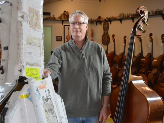 It was marked 'Fragile!' Bassist/luthier Andy Stetson shows a damaged hard case for a bass at the Cincinnati Bass Cellar in Westwood.