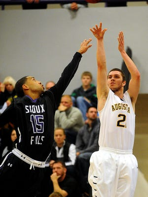 Augustana's #21 Matthew Brazendale takes a shot over USF's #15 Robert Goffney during a game at the University of Sioux Falls Stewart Center in Sioux Falls on Saturday, Dec. 7, 2013. (Joe Ahlquist / Argus Leader)