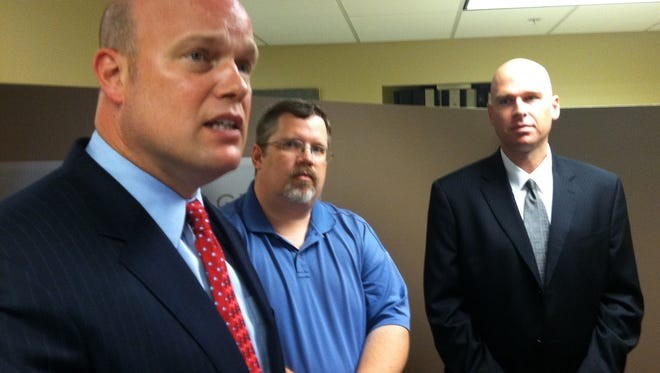 Attorney Matt Whitaker, at left, speaks Wednesday at a news conference at his law office in Des Moines. In the center is fired Newton Daily News editor Bob Eschliman, who was joined by lawyer Jeremiah Dys of the Dallas-based Liberty Institute, a nonprofit group that defends religious liberty.