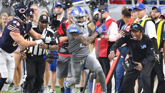 With the Bears in their red zone late in the fourth quarter, the Lions' Darius Slay intercepts a pass intended for the Bears' Daniel Brown, much to the pleasure of Detroit coach Jim Caldwell, turning the ball over to Detroit, which ran out the clock and preserved 20-10 victory.