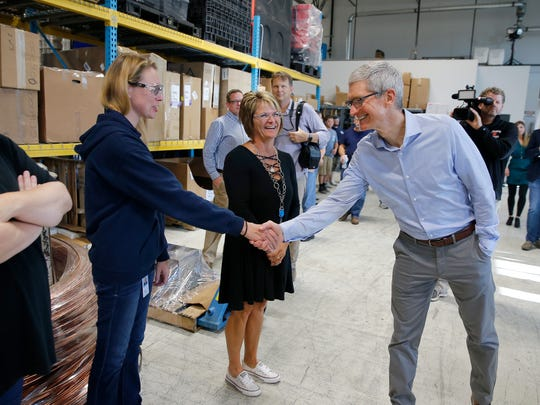 Apple CEO Tim Cook meets employess at Cincinnati Test Systems in Harrison Thursday August 24, 2017. CTS has been a key partner in Apple's ability to produce the first water resistant iPhone with the introduction of iPhone 7 and 7 Plus. CTS developed an high-pressure testing instrument for Apple that puffs air at three times the pressure of a car tire as a way to test for leaks in devices.