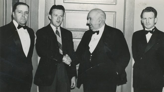 Ray Billows of Poughkeepsie, second from left, a member of the U.S. Walker Cup golf team, shakes hands with Mayor James Spratt at a dinner-dance before Billows left to compete against the British team in 1938. He was honored at the dinner by his Western Publishing Co. co-workers. Firm manager Charles T. Brose is on the far left and Chairman Augustine Beattie is at far right.