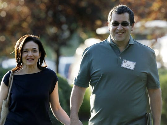 Sheryl Sandberg, COO of Facebook, and her late husband,