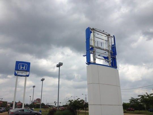 Damaged signs at Bob Boyte Honda in Brandon, Mississippi.
