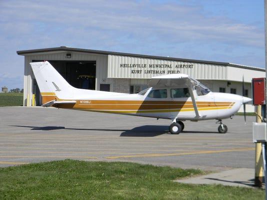 cessna airplane leaves airport.JPG