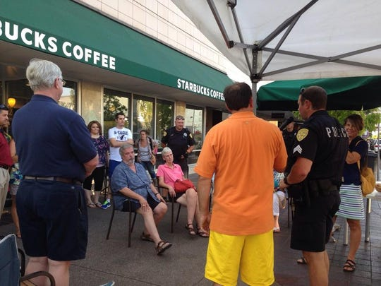 Sgt. Treven Upkes of the Salem Police Department speaks with Salem residents about downtown safety as well as good communication with neighbors at the 31st annual National Night Out.