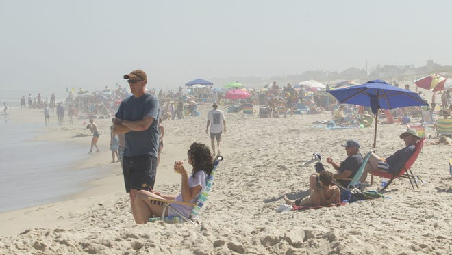Beachgoers enjoy a warm day in Ship Bottom last year.