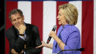 Hillary Clinton speaks as U.S. Sen. Sherrod Brown of Ohio looks on during a campaign stop in July at the University of Cincinnati.