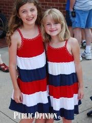 Abby and Avery Porter turned out in red. white and blue dresses for Chambersburg's Memorial Day parade in 2012.