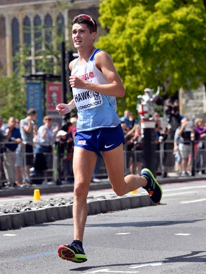 Britain's Callum Hawkins races in the Men's Marathon during the World Athletics Championships Sunday, Aug. 6, 2017. (AP Photo/Martin Meissner)