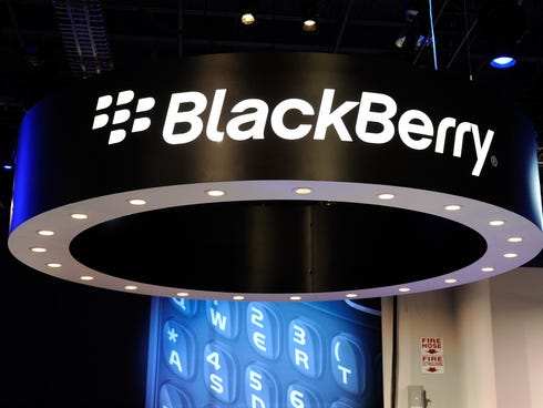 Signs appear at the Blackberry booth at the 2012 International Consumer Electronics Show in Las Vegas.