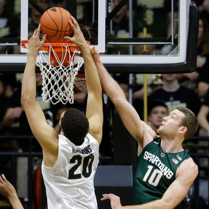 Michigan State forward Matt Costello (10) fouls Purdue center A.J. Hammons (20) as he shoots in the first half of an NCAA college basketball game in West Lafayette, Ind., Tuesday, Feb. 9, 2016. (AP Photo/Michael Conroy)