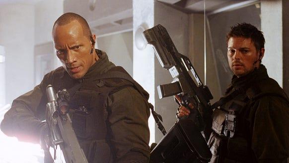 "Dwayne ""The Rock"" Johnson and Karl Urban in ""Doom."""