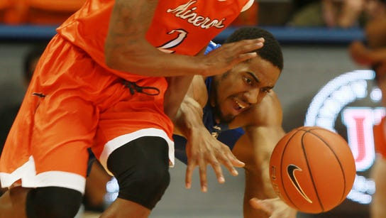 UTEP's Omega Harris avoided a sprawling steal attempt