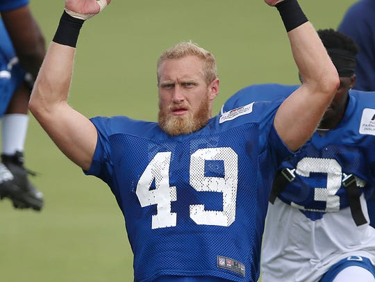 Konrad Reuland stretches during the Indianapolis Colts