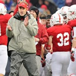 St. John's offensive coordinator Kurt Ramler celebrates a touchdown with the team in the second quarter on Oct. 12 against Augsburg at Clemens Stadium in Collegeville.