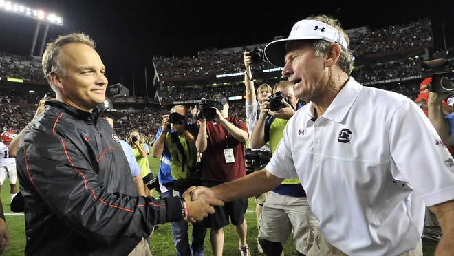 USC coach Steve Spurrier, right, has won four of his past five meetings with Georgia coach Mark Richt.