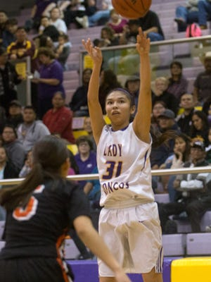 Kirtland Central's Tiajhae Nez shoots a 3-pointer against Gallup on Friday at Bronco Arena in Kirtland.