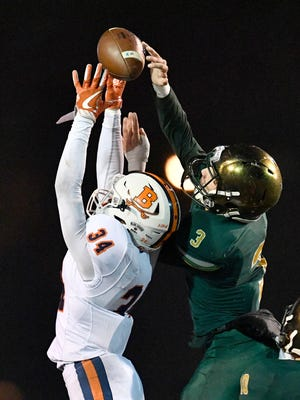 Knoxville Catholic's Jack Jancek (3) breaks up a pass intended for Beech's Dyilin Hoosier (34) during the second half of the Class 5A state championship game at Tucker Stadium in Cookeville, Tenn., Thursday, Nov. 30, 2017.