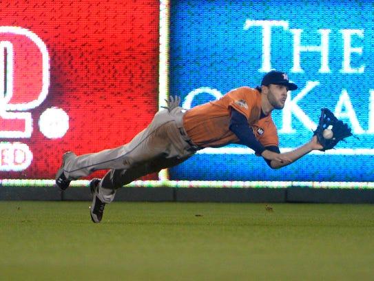 Center fielder Jake Marisnick makes a diving catch