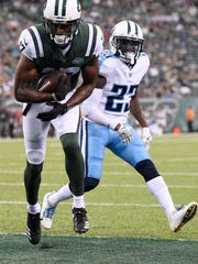 Jets wide receiver Charone Peake (17) catches a touchdown pass during the first quarter of a preseason game against the Titans at MetLife Stadium Saturday, Aug. 12, 2017 in East Rutherford, N.J..