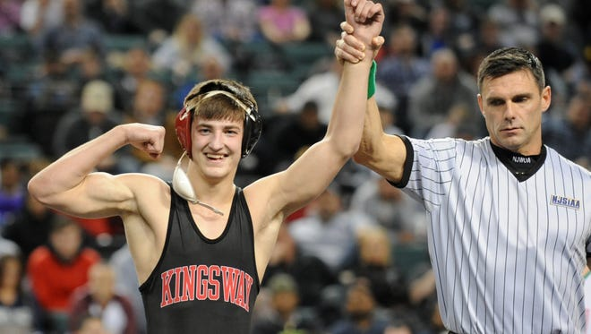 Kingsway's Quinn Kinner flexes after winning the 132-lb state final over New Milford's John Burger during the NJSIAA wrestling tournament finals at Boardwalk Hall in Atlantic City on Sunday.