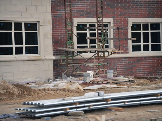 Construction on CCTEC's new College Drive building is progressing as windows and a brick facade are seen at the school.