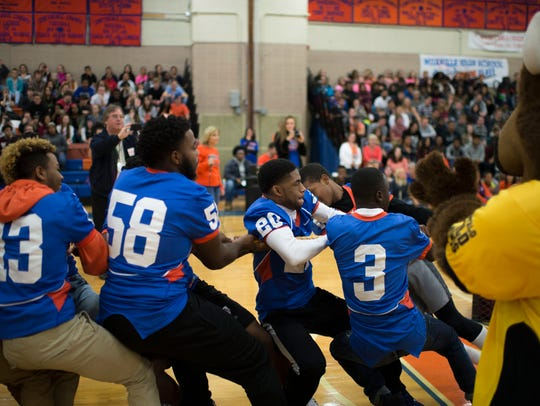 The Millville football team takes on the faculty in