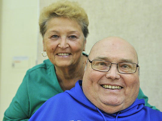 Dean Taylor and his wife, Kathy, smile at St. Cloud