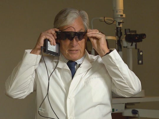 Doctor wears Argus II Retinal Prosthesis System