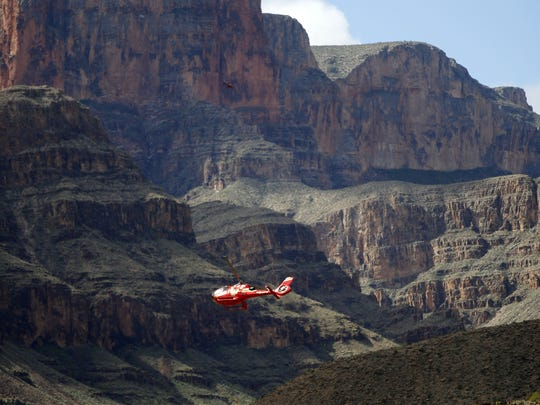 A Papillon Grand Canyon Helicopter flies over the Colorado River through the Hualapai Reservation and the adjacent western part of Grand Canyon National Park.