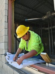 Logan Ieslin, an electrician for Cheney Electric,
