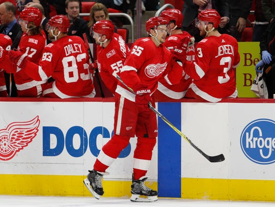 Red Wings defenseman Danny DeKeyser (65) celebrates