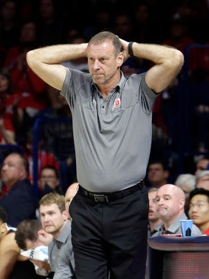 Utah head coach Larry Krystkowiak during the first half of an NCAA college basketball game against Arizona, Thursday, Jan. 5, 2017, in Tucson, Ariz. (AP Photo/Rick Scuteri)