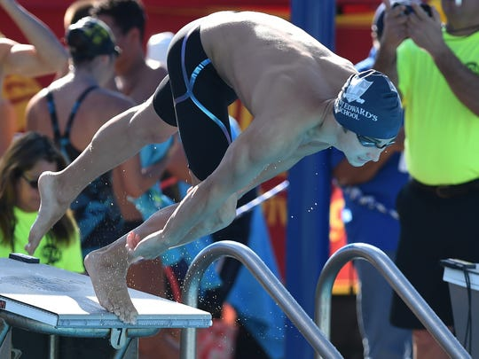 Andrew Brown, of St. Edward's, off the block for the start of the first heat of the Boys 50 Yard freestyle race during the preliminaries of the Florida High School Athletic Association Class 1A Swimming and Diving Finals on Friday, Nov. 11, 2016, at Sailfish Splash Waterpark in Stuart. 