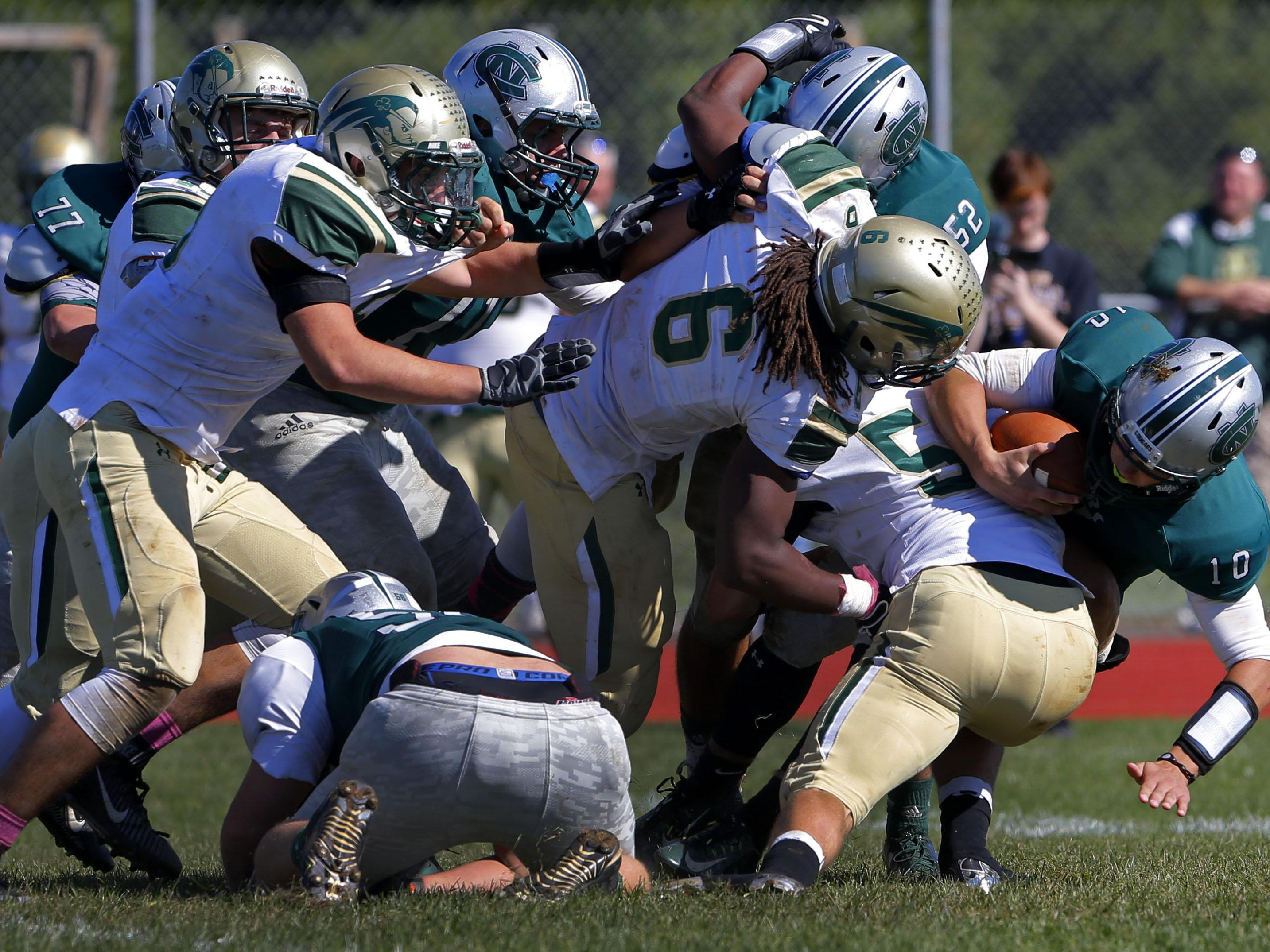 Colts Neck quarterback hayden Volk (10 ) is sacked by Red Bank Catholic defenders during game at Colts Neck High School, Colts Neck,NJ. Saturday, October 10, 2015.