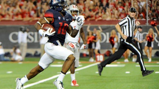 Arizona's Samajie Grant (10) runs for a touchdown against UNLV on Aug. 29, 2014.
