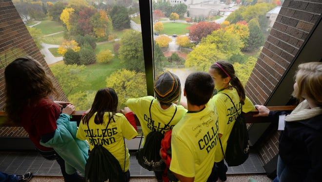 A group of Oconto Middle School students looks out over campus from the eighth floor of the Cofrin Library during the Phuture Phoenix program at UW-Green Bay. The program targets middle school students and promotes the idea of attending college after high school.