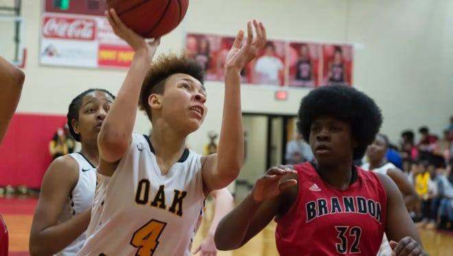 Oak Grove's Derricka Millinghaus goes up for a shot Friday during the Lady Warriors' game against Brandon.