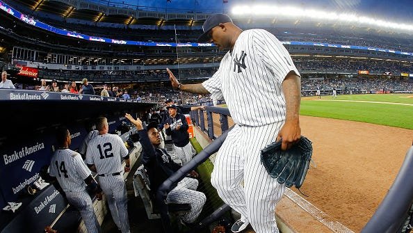 CC Sabathia of the New York Yankees walks into the dugout after the third inning against the Tampa Bay Rays at Yankee Stadium on April 22, 2016 in the Bronx borough of New York City.