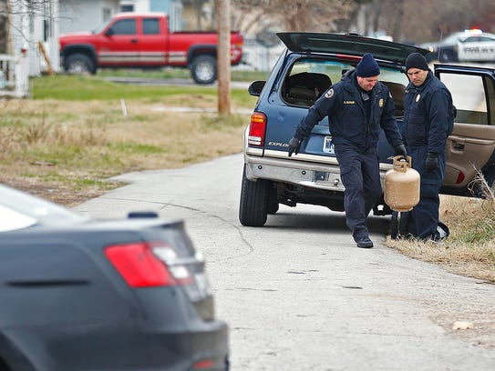 Police and firefighters responded to a vehicle containing