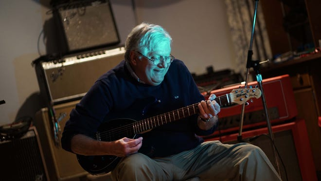 Jeff Bove, a double lung transplant recipient, plays guitar in his recording studio Wednesday.