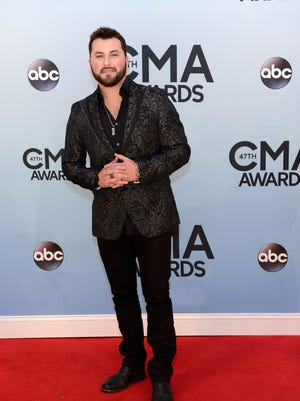 Tyler Farr arrives at the 47th annual CMA Awards at the Bridgestone Arena in Nashville.