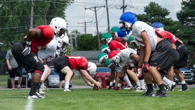 The Ball State football team practices.